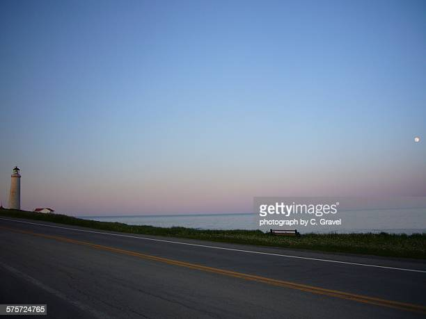 summer evening on the road - cap des rosiers stock pictures, royalty-free photos & images
