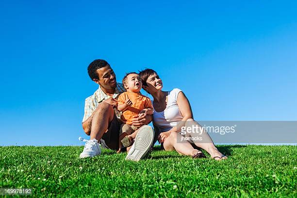 summer family portrait - white wife black baby stock photos and pictures