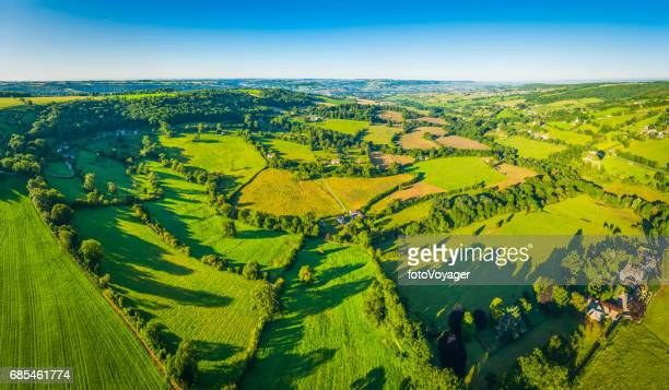 Summer fields green patchwork pasture idyllic country farms aerial panorama
