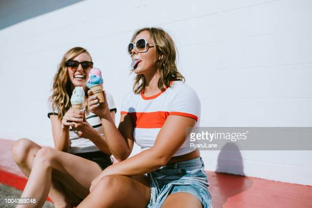 summer friends enjoy ice cream cones on hot day - ice cream stock pictures, royalty-free photos & images