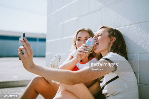 summer friends enjoy ice cream cones on hot day - naughty america stock pictures, royalty-free photos & images