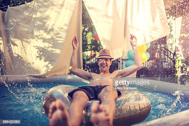 summer fun in a pool - inflatable stock pictures, royalty-free photos & images