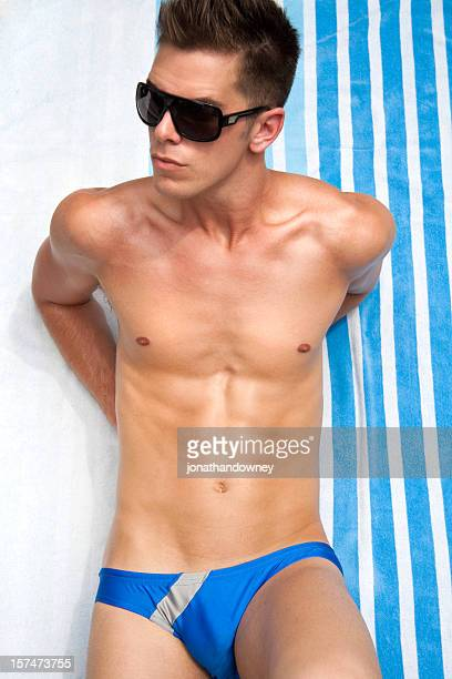 summer guy - young men in speedos stock photos and pictures