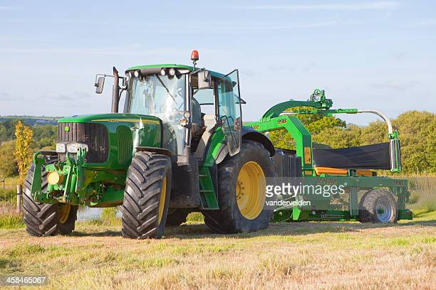 summer haymaking - john deere tractor stock photos and pictures