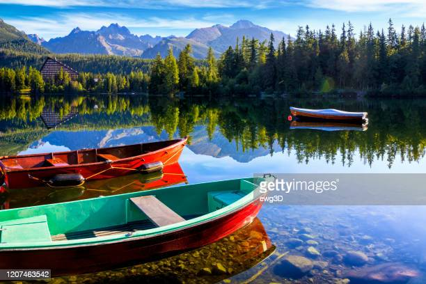 summer holiday morning at the strbske pleso mountain lake, slovakia - slovakia stock pictures, royalty-free photos & images