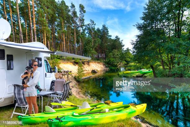 summer holiday with a canoe in poland - camping stock pictures, royalty-free photos & images