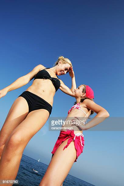 summer holidays - tall blonde women stock photos and pictures