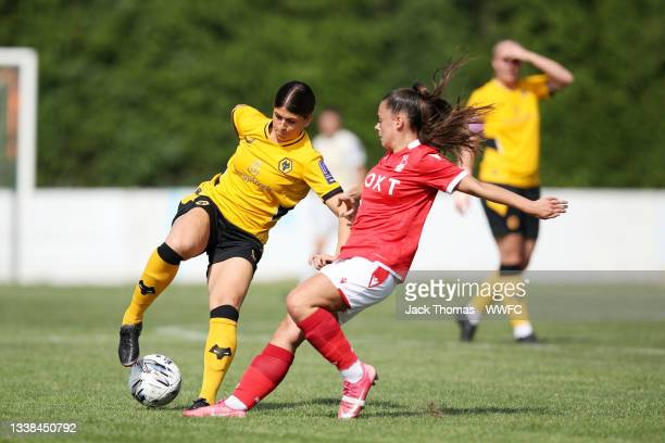 Summer Holmes of Wolverhampton Wanderers is challenged by Freya Thomas of Nottingham Forest Women during the FAWNL Northern Premier Division match...