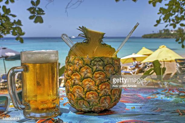 Summer Hot Beach with a cold beer and a pineapple drink on a sunny day