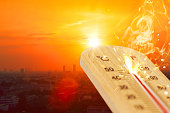 summer hot weather season high temperature thermometer with city view.