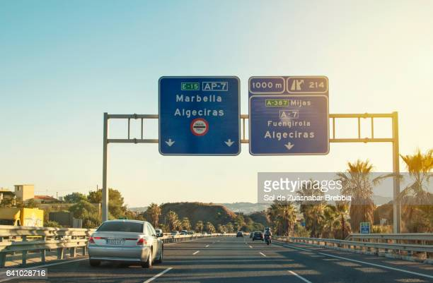 summer image of a coastal highway in the south of spain full of beautiful sunlight - fuengirola stock photos and pictures