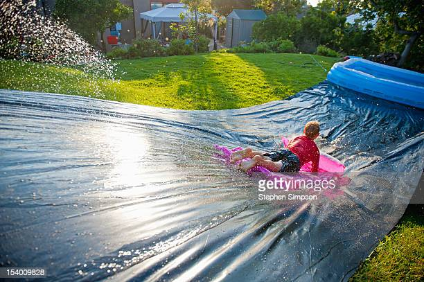 Summer, improvised backyard water slide
