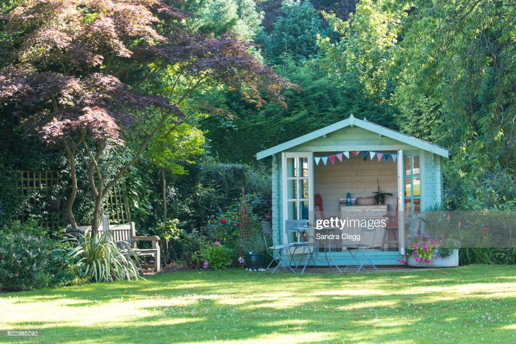 Summer in the garden with the summer house : Stock Photo