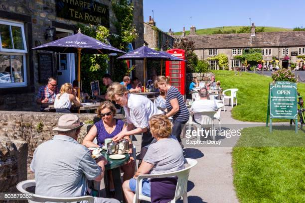 Summer in the Yorkshire Dales - A busy tearoom beside the River Wharfe at Burnsall in Wharfedale, North Yorkshire UK