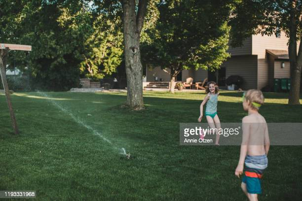 summer kids playing - annie sprinkle stock pictures, royalty-free photos & images