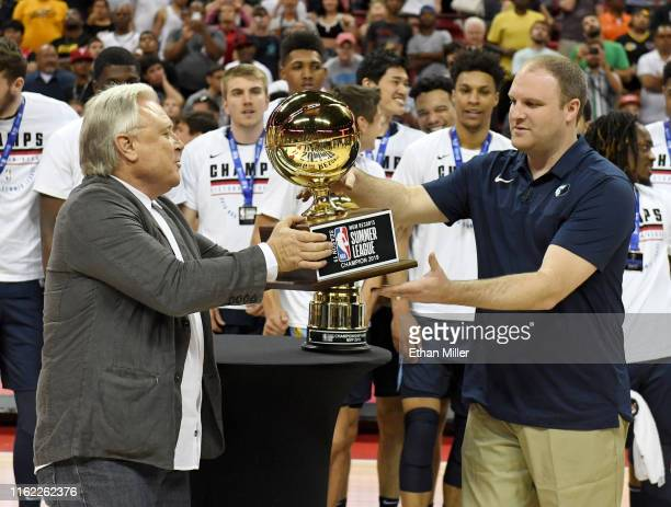 Summer League cofounder Warren LeGarie presents head coach Taylor Jenkins of the Memphis Grizzlies with the championship trophy after his team's 9592...