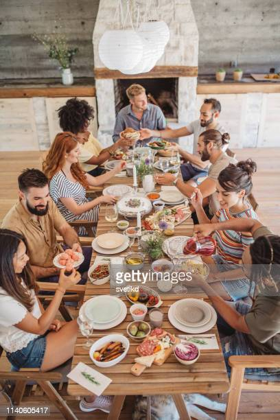 summer lunch on porch - party host stock pictures, royalty-free photos & images