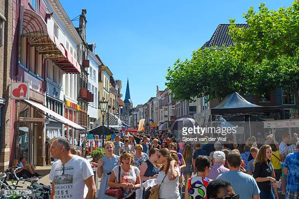 summer market with people shopping in the city of kampen - overijssel stock pictures, royalty-free photos & images