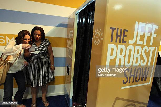 Summer Meacham of Los Angeles and Celena Smith of Portland Oregon check out their photo booth pictures in the audience party room before the start of...