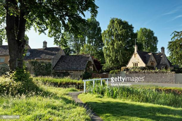 Summer morning in the village of Lower Slaughter in the Cotswolds, Gloucestershire, England