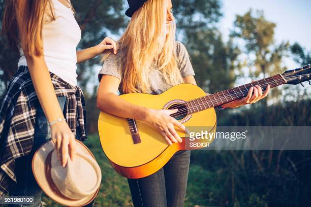 summer music - plucking an instrument stock pictures, royalty-free photos & images