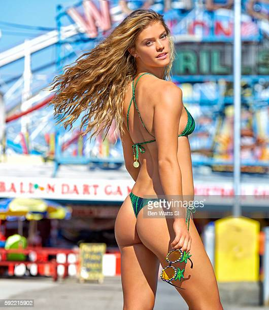 Model Nina Agdal poses for the 2016 Sports Illustrated Summer of Swim issue on June 17 2016 at Coney Island in Brooklyn New York Swimsuit by Matthew...