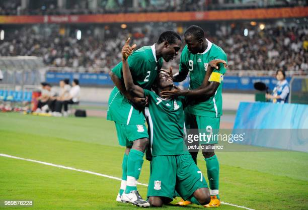Summer Olympics 2008 Beijing football soccer men August 19th 2008 Nigeria Belgium Chinedu OGBUKE OBASI is celebrating with Chibuzor OKONKWO and...