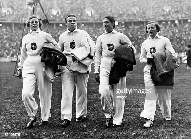 The German 4 x 100 m relay of Women after their world record of 464 sec at one of the heats 8th August 1936 Keystone photograph Berlin 181 242 cm...
