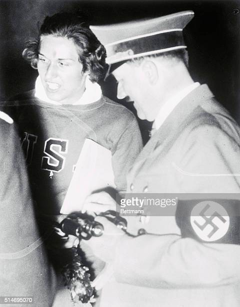 Summer Olympics. Berlin, Germany: OUR HELEN GREETED BY FUEHRER. Helen Stephens,U.S.woman sprint star from Fulton, MO., is honored by being the first...