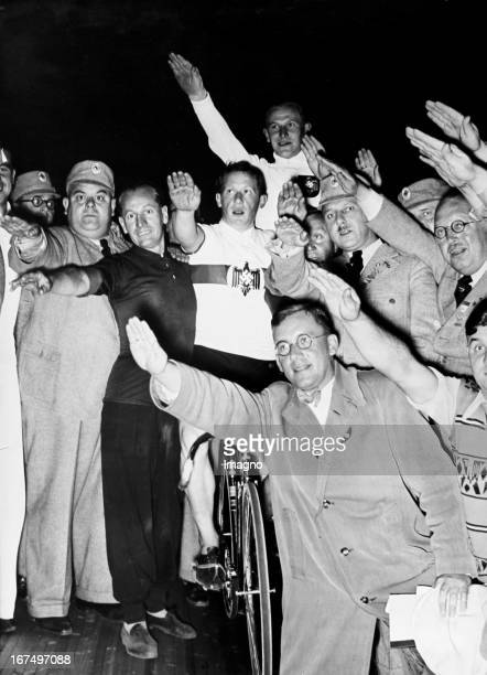 """Summer Olympics in Berlin. World champion and Olympia winner of 1936: Anton """"Toni"""" Merkens. Here you can seem him with his comrades after his victory..."""