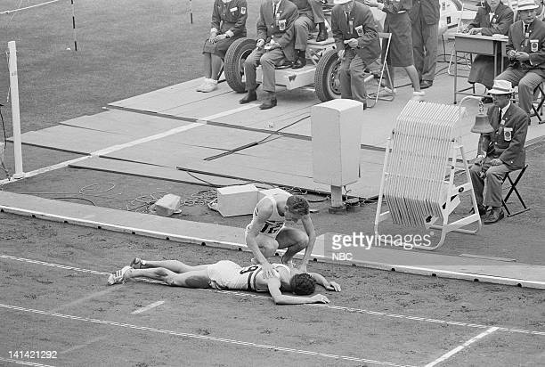 A Track and Field runner attends to his fallen countryman during the 1964 Olympic Games held in Tokyo Japan Photo by NBCU Photo Bank