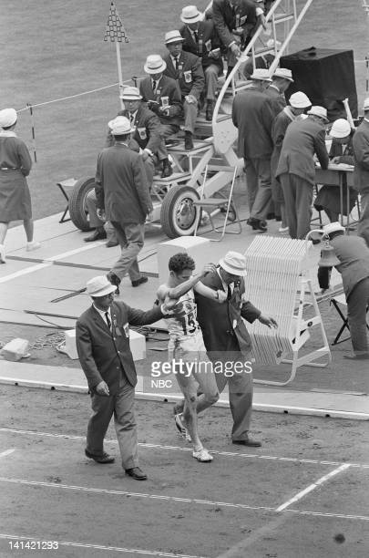 Officials attend to a track and field runner after falling during the 1964 Olympic Games held in Tokyo Japan Photo by NBCU Photo Bank