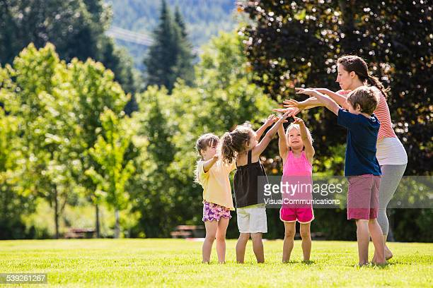 summer outdoor daycare. - school gymnastics stock photos and pictures