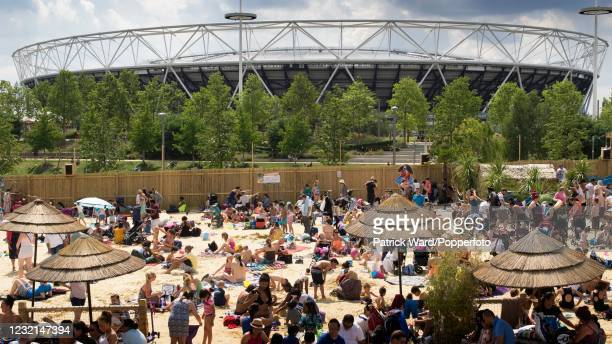 Summer pop-up beach in the shadow of the 2012 Olympic Stadium, at Stratford in the East end of London, England on 8th August 2015.