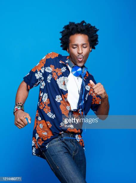 summer portrait od funky young man in hawaiian shirt - mid adult stock pictures, royalty-free photos & images