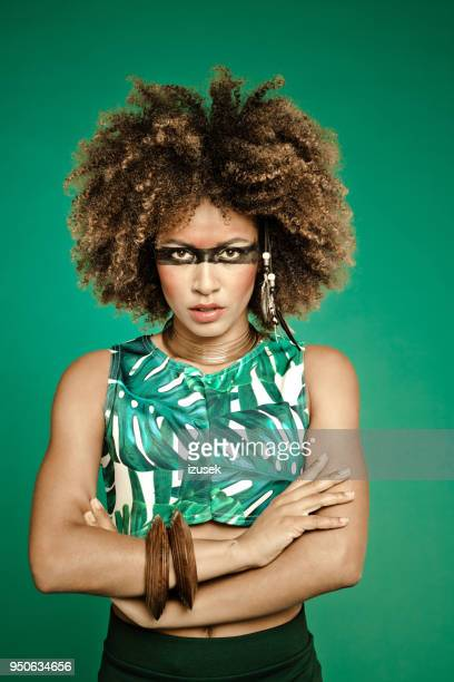 summer portrait of confident young woman wearing leaf pattern top - crazy holiday models stock photos and pictures
