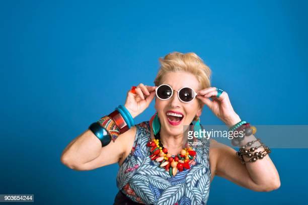 Summer portrait of creative senior woman