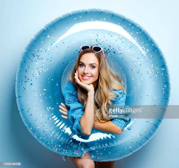 summer portrait of cute young woman, stock photo - rubber ring stock pictures, royalty-free photos & images