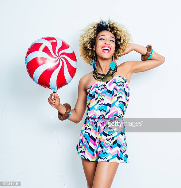 Summer portrait of excited afro american young woman