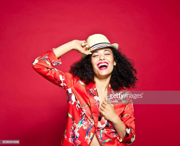 summer portrait of excited young woman against red background - fashion stock pictures, royalty-free photos & images
