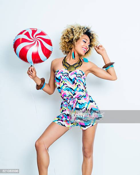 Summer portrait of sensual afro young woman with balloon