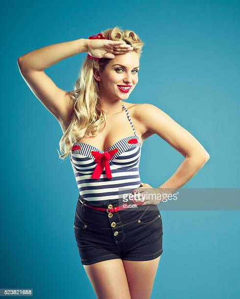 Summer portrait of sensual pin-up style sailor blonde woman