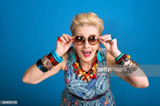 summer portrait of young at heart senior woman - young at heart stock pictures, royalty-free photos & images