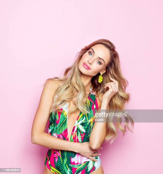 summer portrait of young blonde woman in swimsuit - swimwear stock pictures, royalty-free photos & images