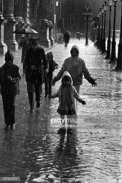Summer Rain At Carrousel In 1981 Children Under The Rain