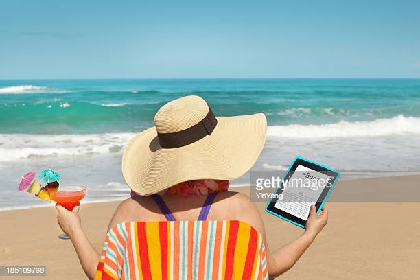 Summer Reading with eBook Tablet Computer on the Tropical Beach
