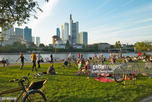 Summer relaxing at the river Main, Sachsenhausen with view towards the bank houses, Commerzbank and
