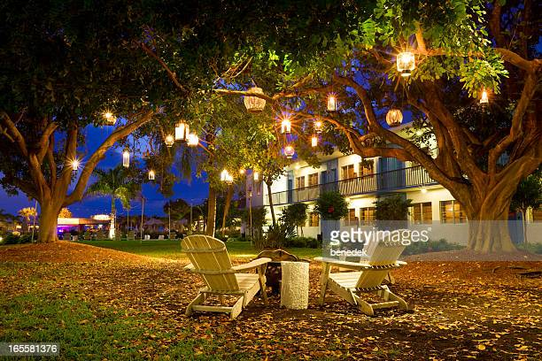 summer resort garden lanterns and chairs - st. petersburg florida stock pictures, royalty-free photos & images