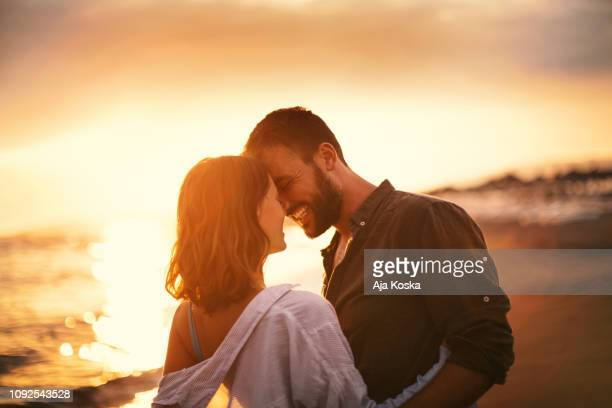 summer romance. - young couple stock pictures, royalty-free photos & images