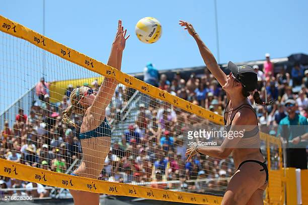 Summer Ross blocks the ball hit from Angela Bensend during their quarter final match at AVP Beach Volleyball Manhattan Beach on July 16 2016 in...
